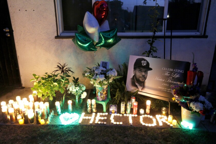A memorial for Hector Hernandez at his former home on the one-year anniversary of his death in Fullerton.