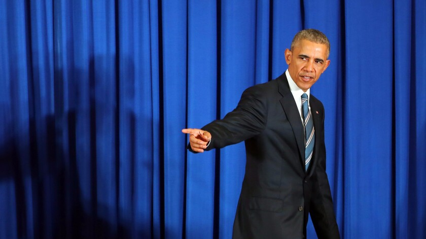 President Obama leaves the stage after a news conference at the International Convention Center in Hanoi.