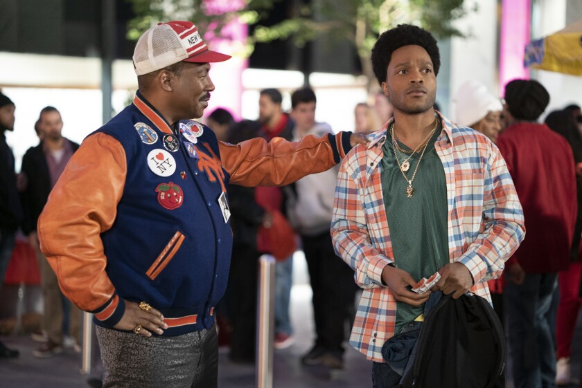 """Eddie Murphy, left, and Jermaine Fowler appear in a scene from """"Coming 2 America."""" (Quantrell D. Colbert/Paramount Pictures via AP)"""