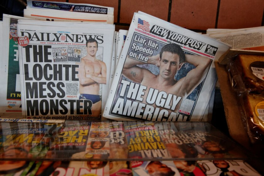 The front pages of the New York Post and the New York Daily News display the image of U.S. Olympic swimmer Ryan Lochte in New York