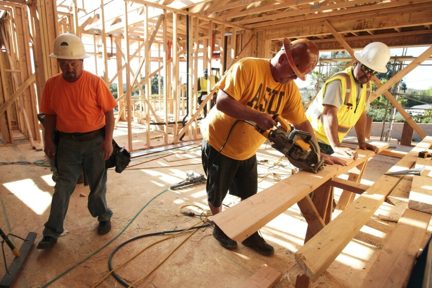 CARLSBAD, February 10, 2016 | Nica Romero, left, Neil Hayes, center, and David Codarrvbias work in one of two model homes under construction at Lanai by Shea Homes, a twenty home development in Carlsbad on Wednesday.  | -Mandatory Photo Credit: Photo by Hayne Palmour IV/San Diego Union-Tribune, LLC