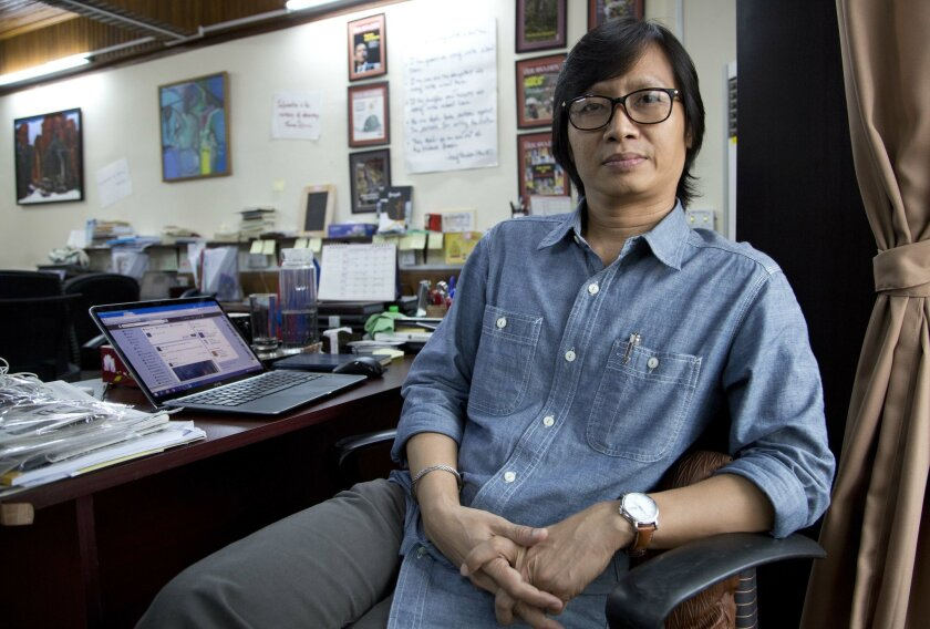In this Monday Nov. 2, 2015 photo Kyaw Zwa Moe, editor of The Irrawaddy, sits at his desk in his newsroom in Yangon, Myanmar. Their predecessors suffered torture, imprisonment and death at the hands of a die-hard military regime for more than half a century. Now, Myanmar's journalists, newly fledge