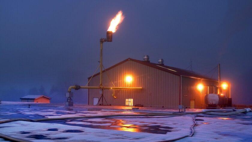 Methane gas burns off at a facility near Monroe, Wash.