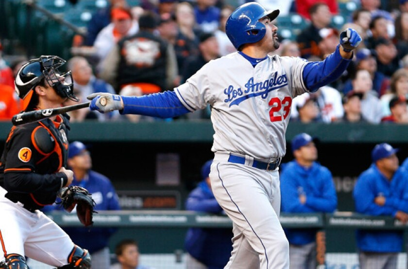 Dodgers first baseman Adrian Gonzalez watches his fly ball that drove in Carl Crawford for the team's only run against the Orioles in the second game of a doubleheader Saturday night in Baltimore.