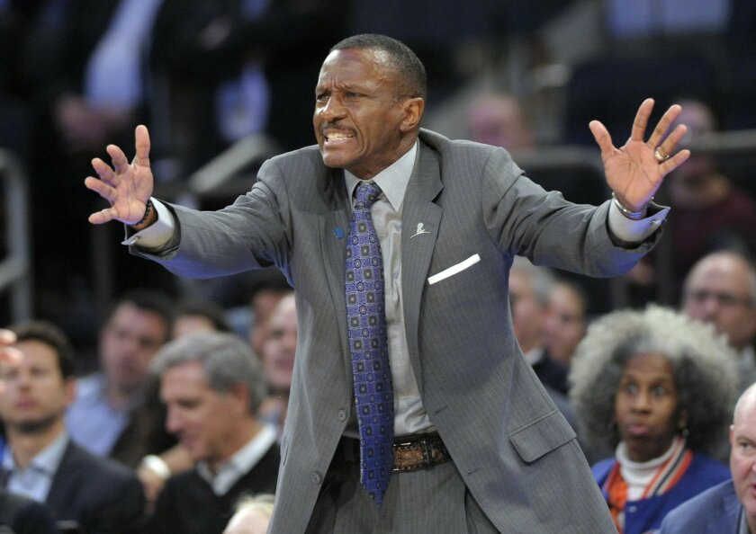 FILE - In this Feb. 22, 2016, file photo, Toronto Raptors coach Dwane Casey reacts during the third quarter of an NBA basketball game against the New York Knicks, at Madison Square Garden in New York.  A person with knowledge of the situation tells The Associated Press that the Toronto Raptors have