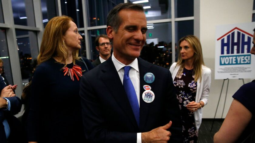 L.A. Mayor Eric Garcetti gives a thumbs up to supporters of Proposition HHH as they celebrate the measure's apparent victory on Nov. 8.