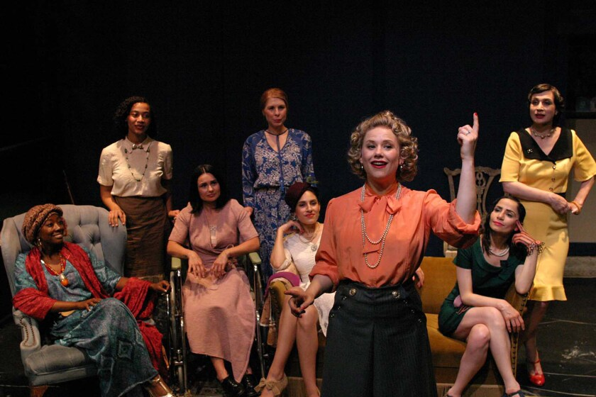 "Tiffany Colein with a group of women seated behind her in ""Fefu and Her Friends"" at the Odyssey."