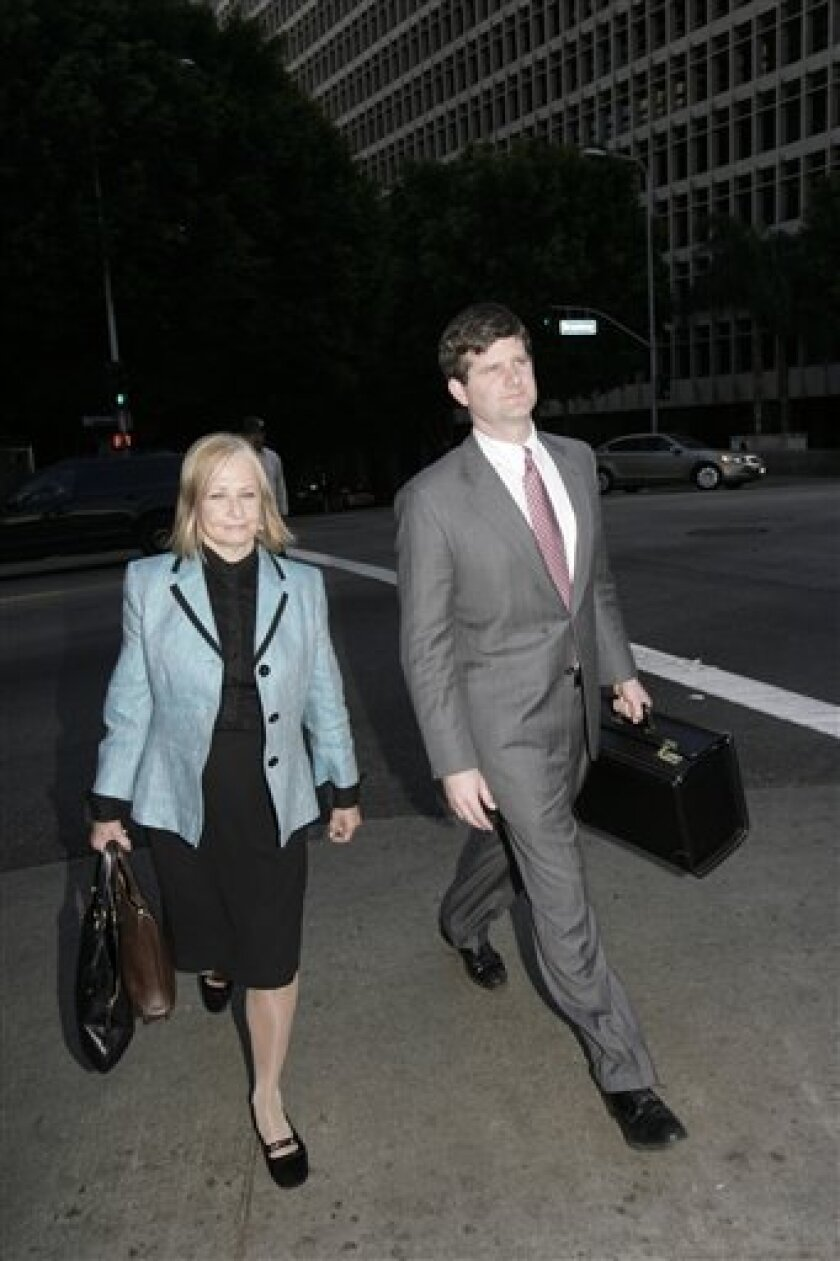 Dr Khristine Eroshevich, left, and her attorney Adam Braun leave court, Friday Oct. 30, 2009, after a judge ruled that Howard K. Stern, Dr. Sandeep Kapoor and Eroshevich stand trial on charges of illegally funneling prescription drugs to the former Playboy model, Anna Nicole Smith, in Los Angeles. (AP Photo/Nick Ut)