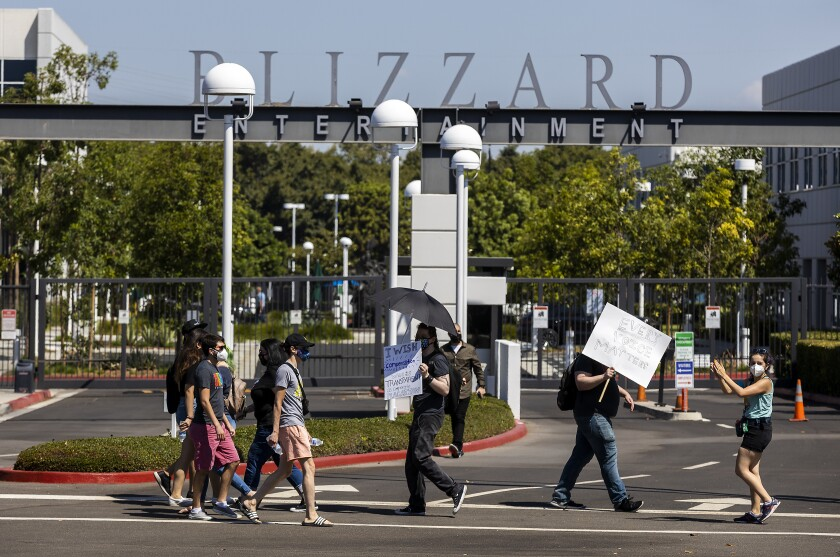 Several hundred Activision Blizzard employees stage a walkout at the company's Irvine office.