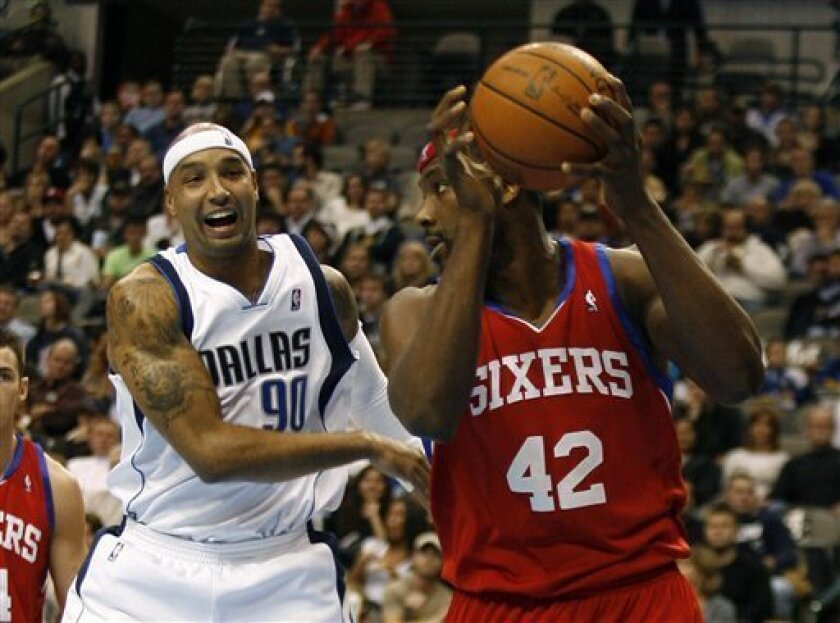 Philadelphia 76ers' Elton Brand, right, grabs a rebound in front of Dallas Mavericks' Drew Gooden in the first half of an NBA basketball game, Monday, Nov. 30, 2009, in Dallas, Texas.  (AP Photo/Mike Stone)