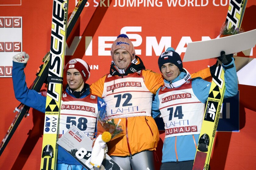 From left, Austria's Stefan Kraft, second placed, Germany's Severin Freund, winner and Poland's Kamil Stoch, third place, celebrate after the Large Hill HS130 competition in the FIS Ski Jumping World Cup in Lahti, Finland, Friday, Feb. 28, 2014. (AP Photo/Heikki Saukkomaa, Lehtikuva)     FINLAND OU