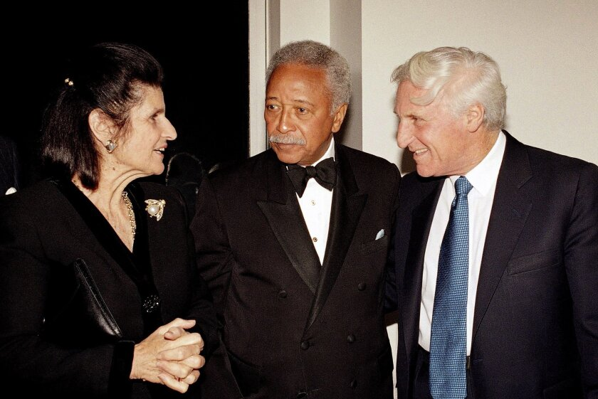 FILE - In this Oct. 23, 1993 file photo, New York City Mayor David Dinkins, center, joins in a conversation with Tel Aviv Mayor Shlomo Lahat, right, and Mrs. Lea Rabin, wife of Israeli Prime Minister Yitzhak Rabin, at a reception for the Tel Aviv Foundation in New York. Former Tel Aviv mayor Lahat, who presided over the city's transformation into a vibrant and open urban center, has died at the age of 87. (AP Photo/David Karp, File)