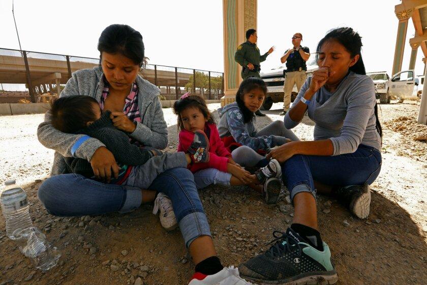 EL PASO, TEXAS--JUNE 21, 2019--Lucero Gerarald, age 22, left, gives her son Gael Ria, age 1 1/2, and
