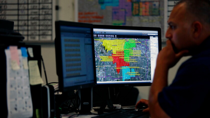LAPD Officer David Gamero monitors crime trends and deploys police resources in real time from the Community Safety Operation Center.