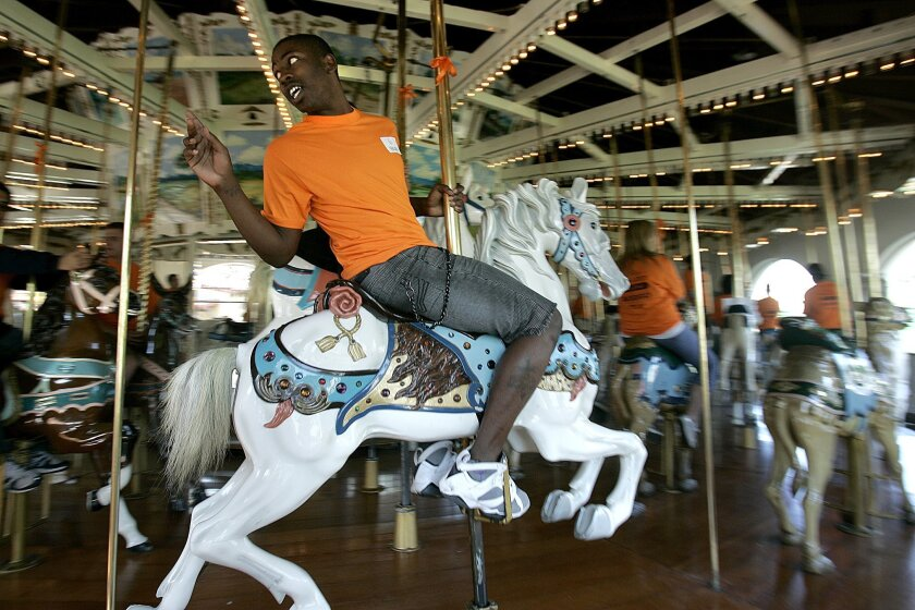 The carousel at Seaport Village was hand-carved in 1895. Hop on for $2. John Gastaldo • U-T