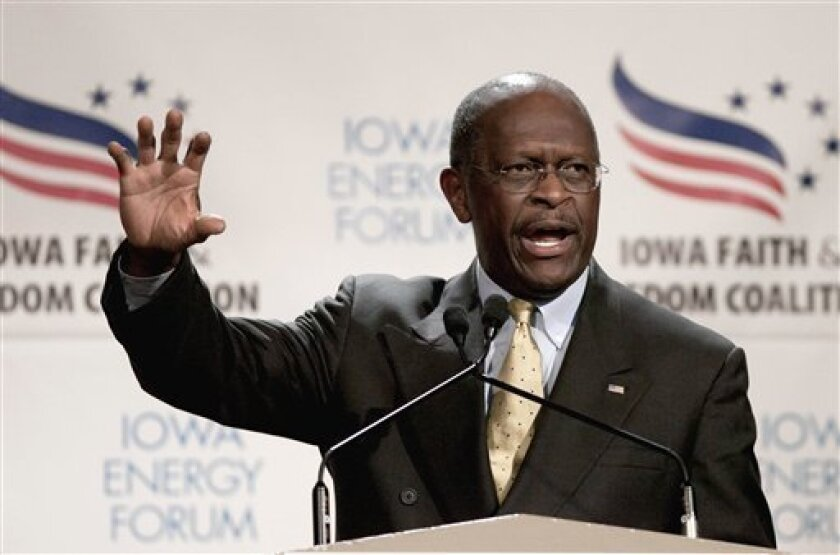 FILE - In this Oct. 22, 2011 file photo, Republican presidential candidate, businessman Herman Cain speaks in Des Moines, Iowa. The flat tax is making a comeback among Republican presidential candidates. Most of the contenders _Mitt Romney's an exception _ offer a variation of the tax plan under wh