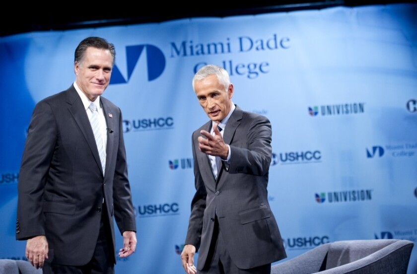 Univision anchor Jorge Ramos, right, with Republican presidential nominee Gov. Mitt Romney during a candidate's forum in the run-up to the Florida primary on Jan. 25, 2012.