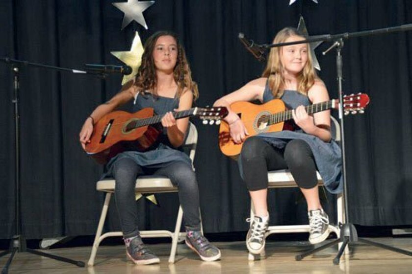 Fifth-graders Georgia Figueiredo and Kennedy Snyder perform a duet.