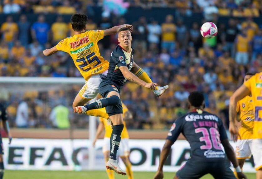 Tigres winger Jürgen Damm (L) fights for the ball with America's Andres Uribe (R) during the Liga MX match played on Oct. 6, 2018, at Universitario Stadium in Monterrey, Mexico. EPA-EFE FILE/Miguel Sierra
