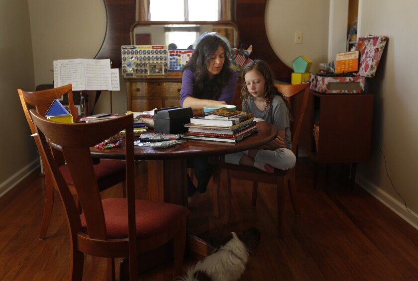 Kimberly Rotter worked on school work with her daughter Moxie at their home in October.