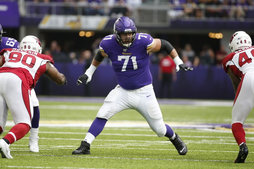 FILE - Minnesota Vikings offensive tackle Riley Reiff (71) looks to make a block during the first half of an NFL preseason football game against the Arizona Cardinals, Saturday, Aug. 24, 2019, in Minneapolis. Minnesota's offensive line remains a work in progress, but the Vikings have a trusted teacher to follow in Rick Dennison. (AP Photo/Bruce Kluckhohn, File)