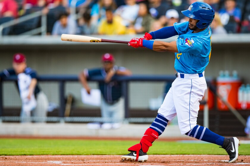 Amarillo Sod Poodles infielder Ivan Castillo (2) hits the ball against the Northwest Arkansas Travelers on Sunday, July 21, 2019, at HODGETOWN in Amarillo, Texas.