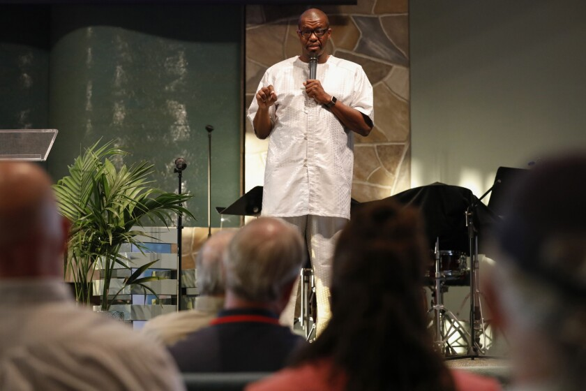 "David Campt lectures to a more than predominately white audience about how to be a ""white ally"" in combating racism at The Unity Center in the Miramar area on August 1."