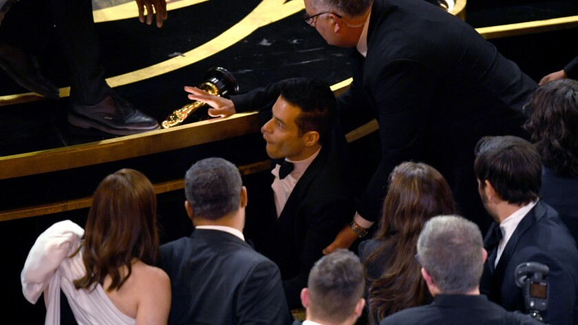 Rami Malek slips shortly after winning the lead actor Oscar at the 91st Academy Awards at the Dolby Theatre in Hollywood.