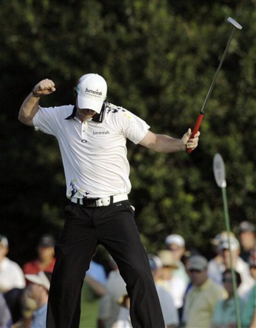 Rory McIlroy of Northern Ireland reacts after making a birdie putt on the 17th hole during the third round of the Masters golf tournament Saturday, April 9, 2011, in Augusta, Ga. (AP Photo/Dave Martin)