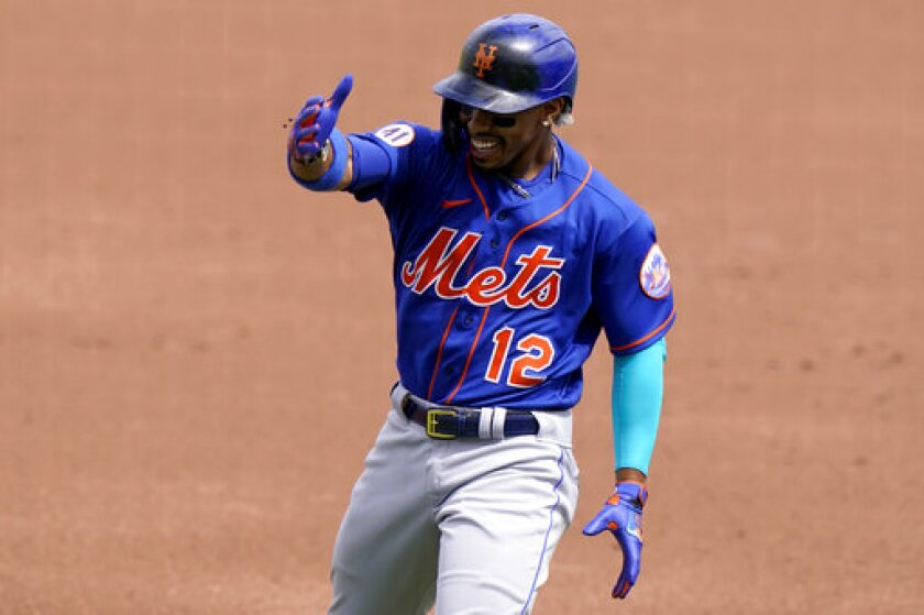 New York Mets' Francisco Lindor (12) reacts after flying out to Washington Nationals center fielder Victor Robles during the first inning of a spring training baseball game, Monday, March 8, 2021, in West Palm Beach, Fla. (AP Photo/Lynne Sladky)