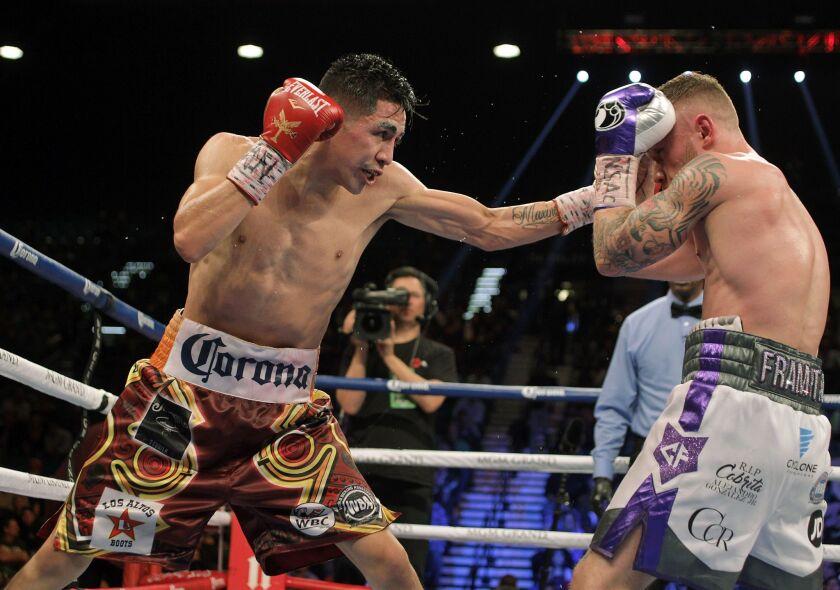 Leo Santa Cruz, left, and Carl Frampton fight at the MGM Grand Arena in Las Vegas on Jan. 28.