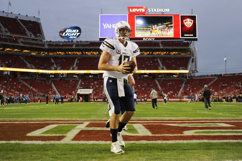 Chargers Philip Rivers warms up against the 49ers.