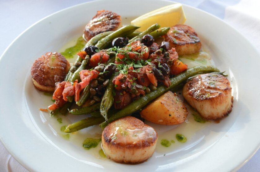 Pan Seared Sea Scallops, with a medley of tomatoes, garlic, capers, olives, green beans and potatoes, dressed with beurre blanc.