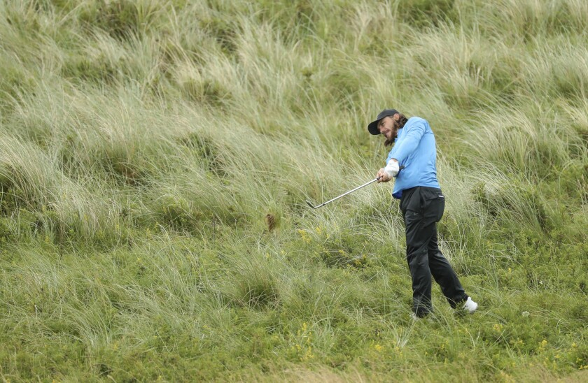 Tommy Fleetwood plays from the rough on the seventh hole during the final round of the British Open on Sunday.