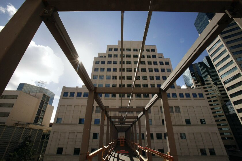 A 165-foot-long bridge connects the new courthouse to the Hall of Justice across C Street. It will be open to the air and make it efficient for jurors, attorneys and the public to access courtrooms in both buildings.