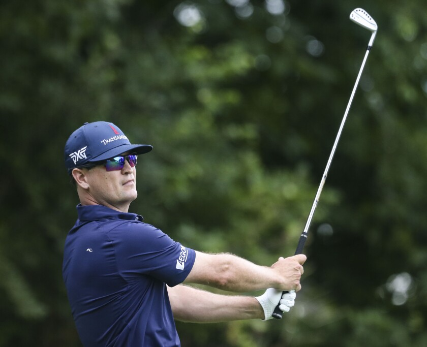 Zach Johnson tees off on the 16th hole during the first round of the John Deere Classic golf tournament Thursday, July 8, 2021, in Silvis, Ill. (Jessica Gallahger/The Dispatch – The Rock Island Argus via AP)