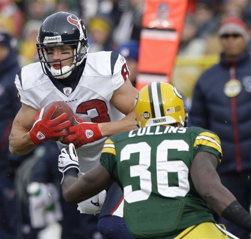 Houston Texans wide receiver Kevin Walter (83) gets away from Green Bay Packers' Nick Collins (36) for a 58-yard touchdown reception during the first half of an NFL football game Sunday, Dec. 7, 2008, in Green Bay, Wis. (AP Photo/Morry Gash)
