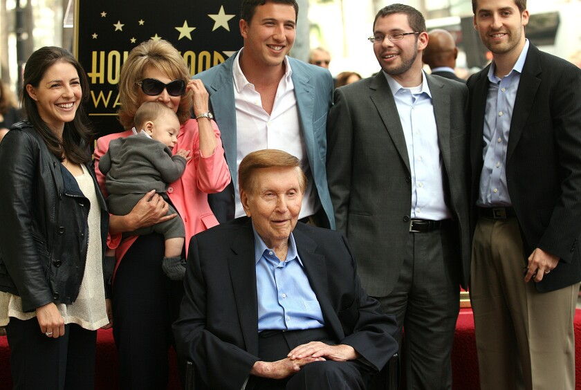 Sumner Redstone, bottom center, surrounded by family, is honored by the Hollywood Chamber of Commerce with a star on the Hollywood Walk of Fame on March 30, 2012.