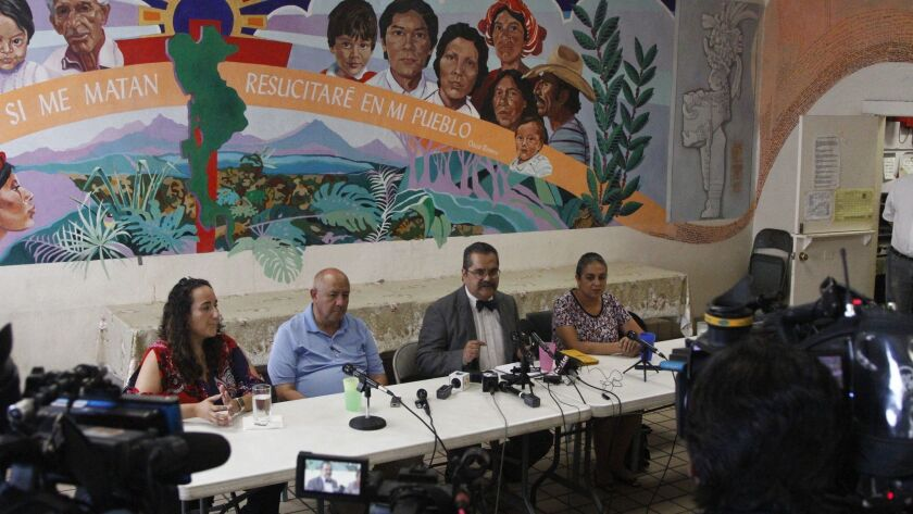 Pediatricians speak to reporters Tuesday, July 2, 2019, about their experiences treating migrant chi