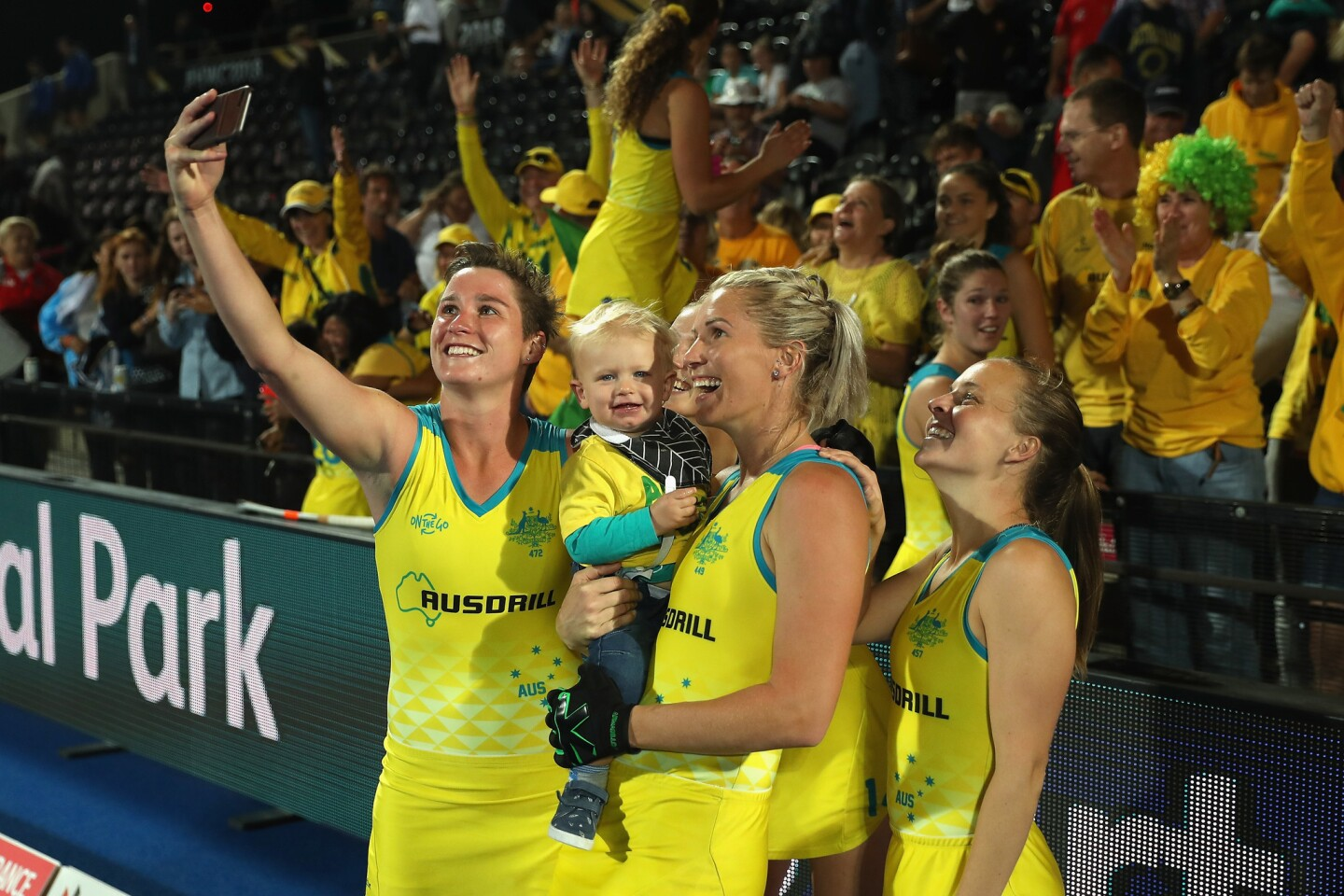 LONDON, ENGLAND - AUGUST 01: Kathryn Slattery of Australia, Jodie Kenny of Australia and Emily Smith of Australia pose for a selfie with family members after their victory during the Quarter Final game between Australia and Argentina of the FIH Womens Hockey World Cup at Lee Valley Hockey and Tennis Centre on August 1, 2018 in London, England. (Photo by Christopher Lee/Getty Images) ** OUTS - ELSENT, FPG, CM - OUTS * NM, PH, VA if sourced by CT, LA or MoD **