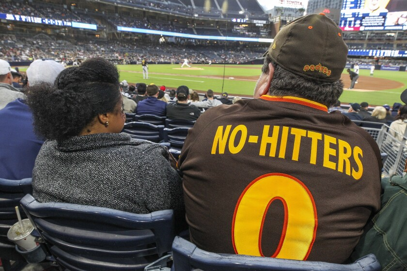 "Dirk Lammers, with wife Angela two years ago at Petco Park, needs to update his ""No-Hitters 0"" Padres jersey."