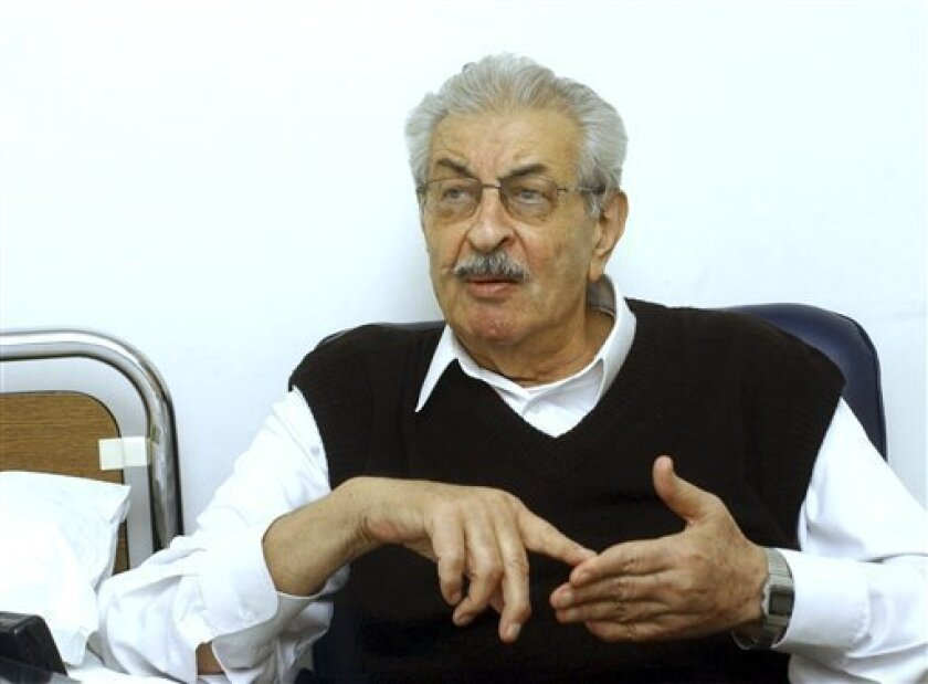FILE - In this Sunday, Feb. 12, 2006 file photo, Mohammed Oudeh, the key planner of the assault on the 1972 Munich Olympics that left 11 Israeli athletes dead, talks during an interview with The Associated Press in a Damascus hospital, Syria. Oudeh, better known by his code name Abu Daoud, has died