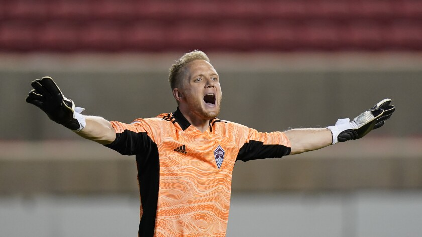 Colorado Rapids goalkeeper William Yarbrough (22) directs his team in the second half of an MLS soccer game against the Vancouver Whitecaps, Sunday, May 2, 2021, in Sandy, Utah. (AP Photo/Rick Bowmer)