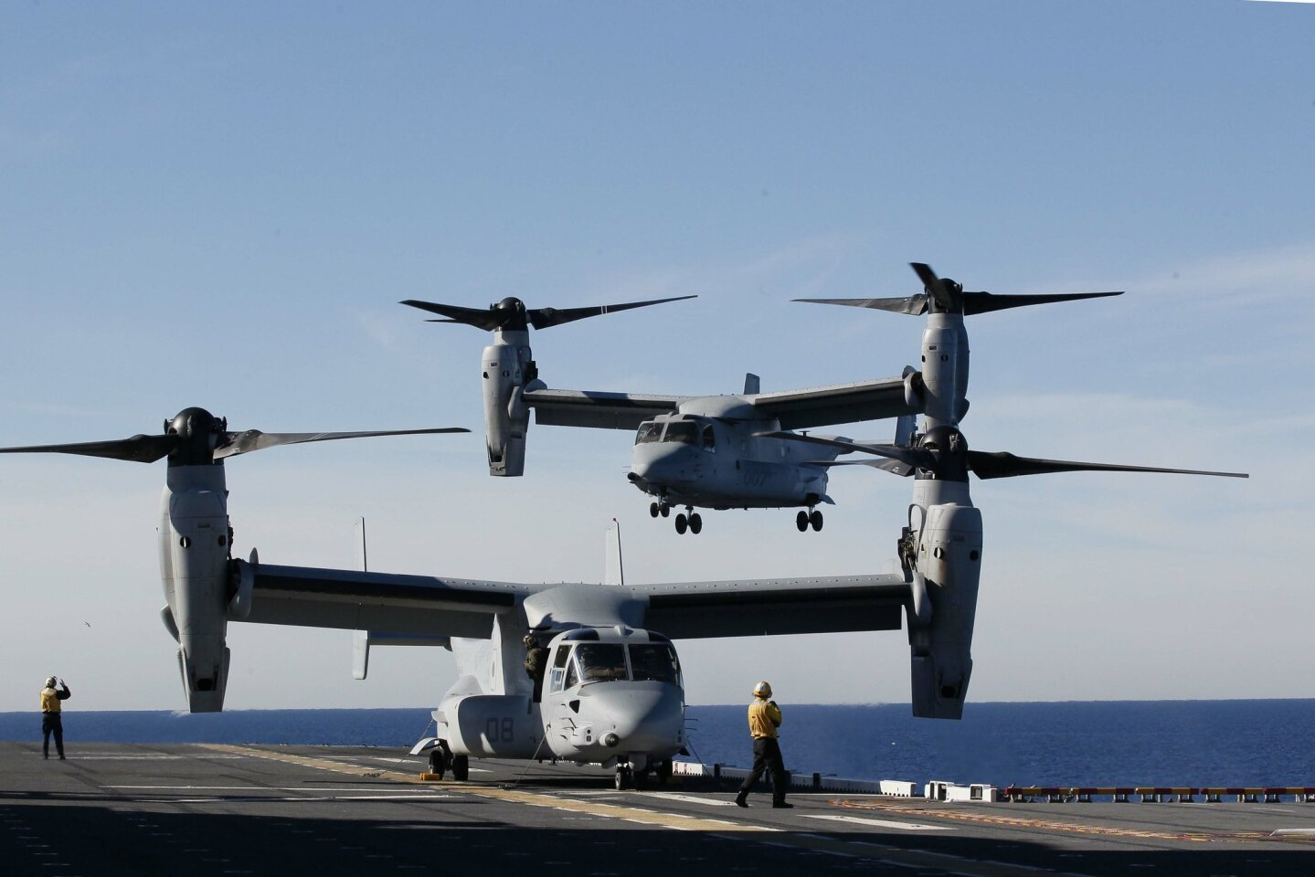 A V-22 Osprey carrying Secretary of Defense Chuck Hagel landed aboard the USS America on Wednesday, January 14, 2015.  Hagel is making a farewell tour, visiting with all branches of the military.  He is leaving the president's cabinet as soon as a replacement is named.