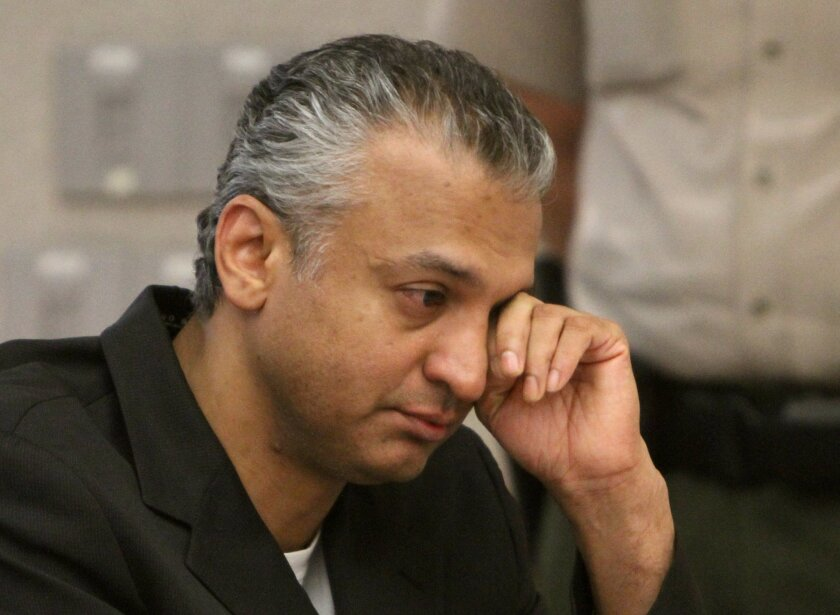 Actor Shelley Malil wipes tears away during his sentencing hearing as he listens to his niece Anjali Varghese speak on his behalf.