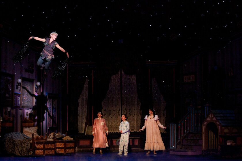 """Cathy Rigby soars over the Darling children in the touring stage musical """"Peter Pan."""""""