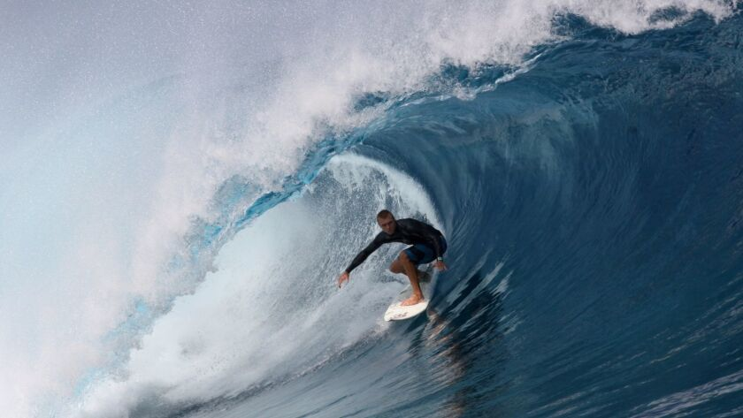 John Maher surfing a 'big tube.'