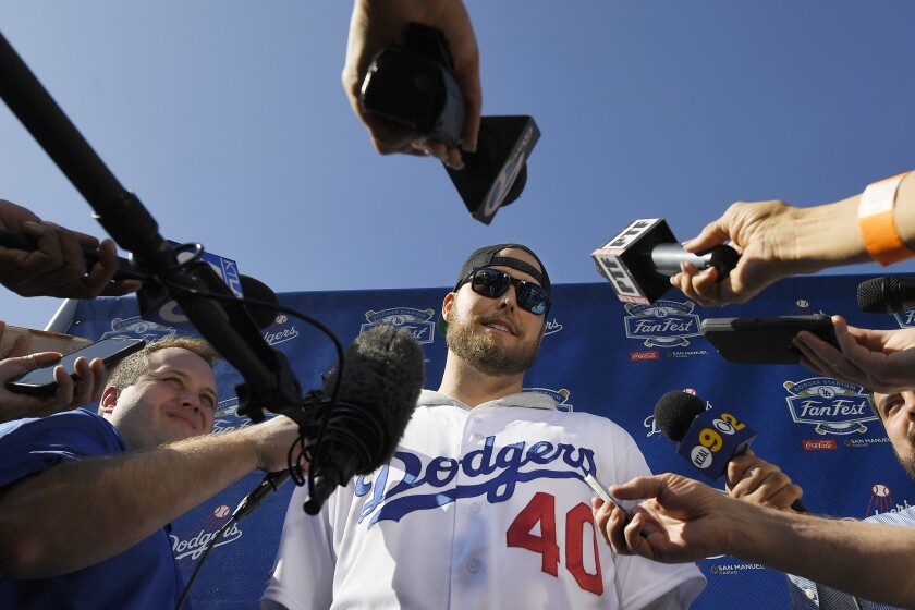 Pitcher Jimmy Nelson is interviewed by reporters during the Dodgers' FanFest on Jan. 25, 2020.