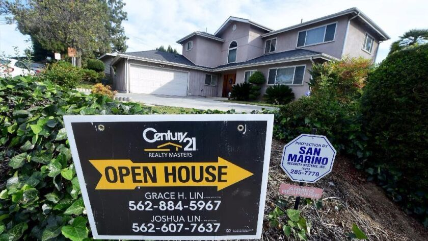 "An ""Open House"" sign directs prospective buyers to property for sale in Monterey Park earlier this year. Southern California home prices keep going up."