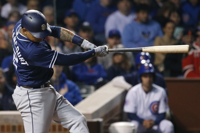 San Diego Padres' Christian Bethancourt hits a solo home run during the fifth inning of a baseball game against the Chicago Cubs Wednesday, May 11, 2016, in Chicago. (AP Photo/Nam Y. Huh)